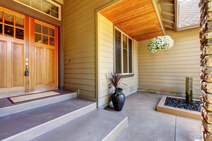 Front entrance door. Exterior of American two story house with concrete walkway and nice landscape desing around. Northwest, USA